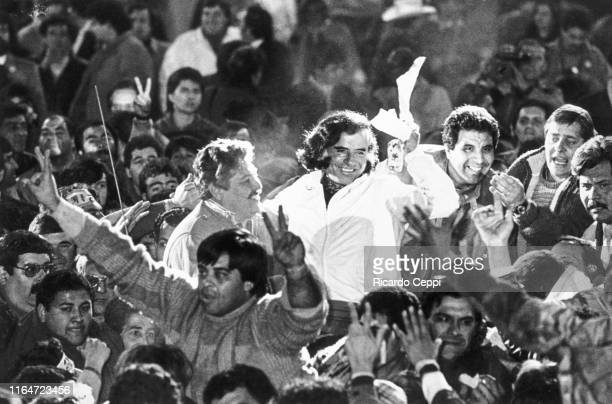 Presidential candidate Carlos Menem greets surrounded by supporters at the closing ceremony held at the River Plate Stadium during an exclusive...