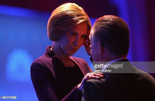 Presidential candidate Carly Fiorina talks with her husband Frank Fiorina during a break at the CNBC Republican Presidential Debate at University of...
