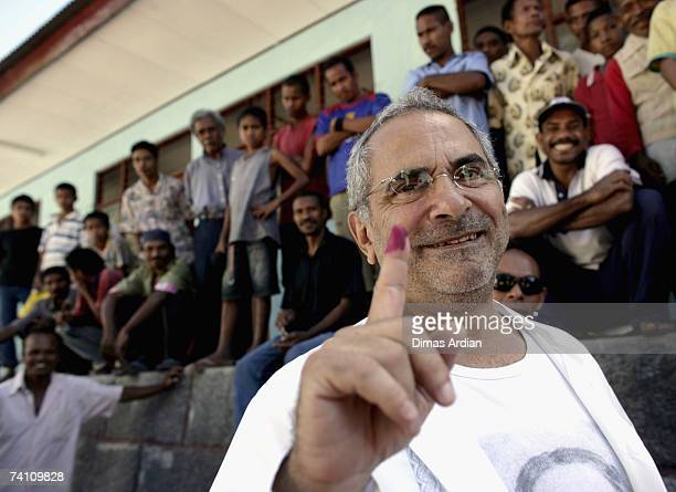 Presidential candidate current Prime Minister and Nobel peace prize winner Jose RamosHorta shows his finger marked by permanent ink after voting as...