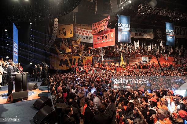 Presidential candidate Daniel Scioli left speaks as supporters look on at his campaign headquarters on election night in Buenos Aires Argentina on...