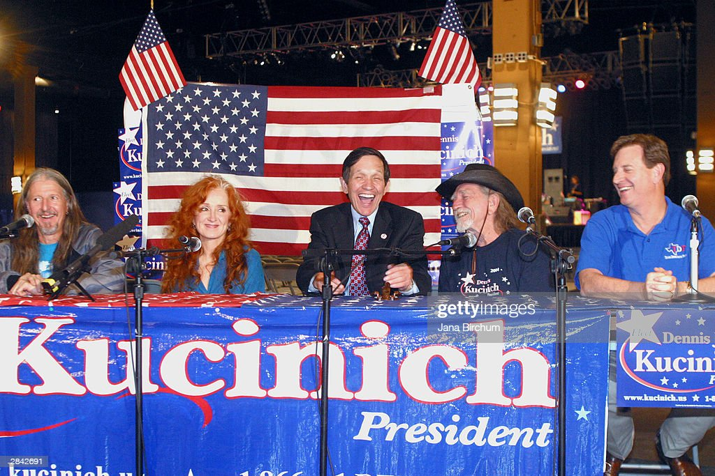 Presidential candidate Dennis Kucinich (C) receives the support of musicians Willie Nelson (2nd R) and Bonnie Raitt (2nd L) at a fundraiser January 3, 2004 in Austin, Texas. The fundraiser was designed to elevate the name of Kucinich, who has received little recognition among voters outside his home state.