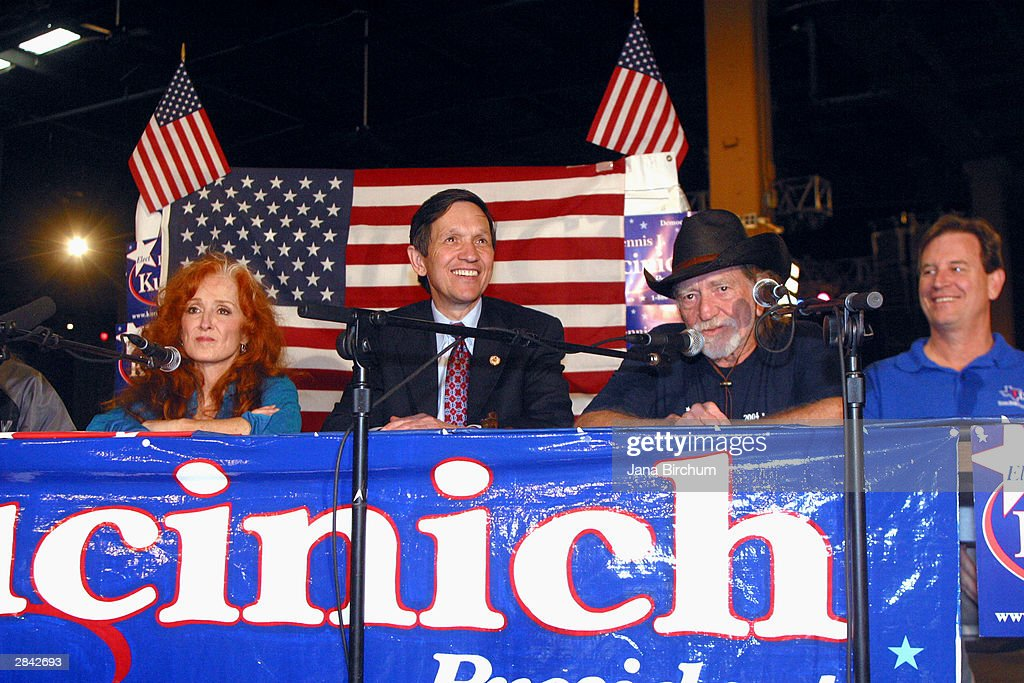 Presidential candidate Dennis Kucinich (2nd L) receives the support of musicians Willie Nelson (2nd R) and Bonnie Raitt (L) at a fundraiser January 3, 2004 in Austin, Texas. The fundraiser was designed to elevate the name of Kucinich, who has received little recognition among voters outside his home state.