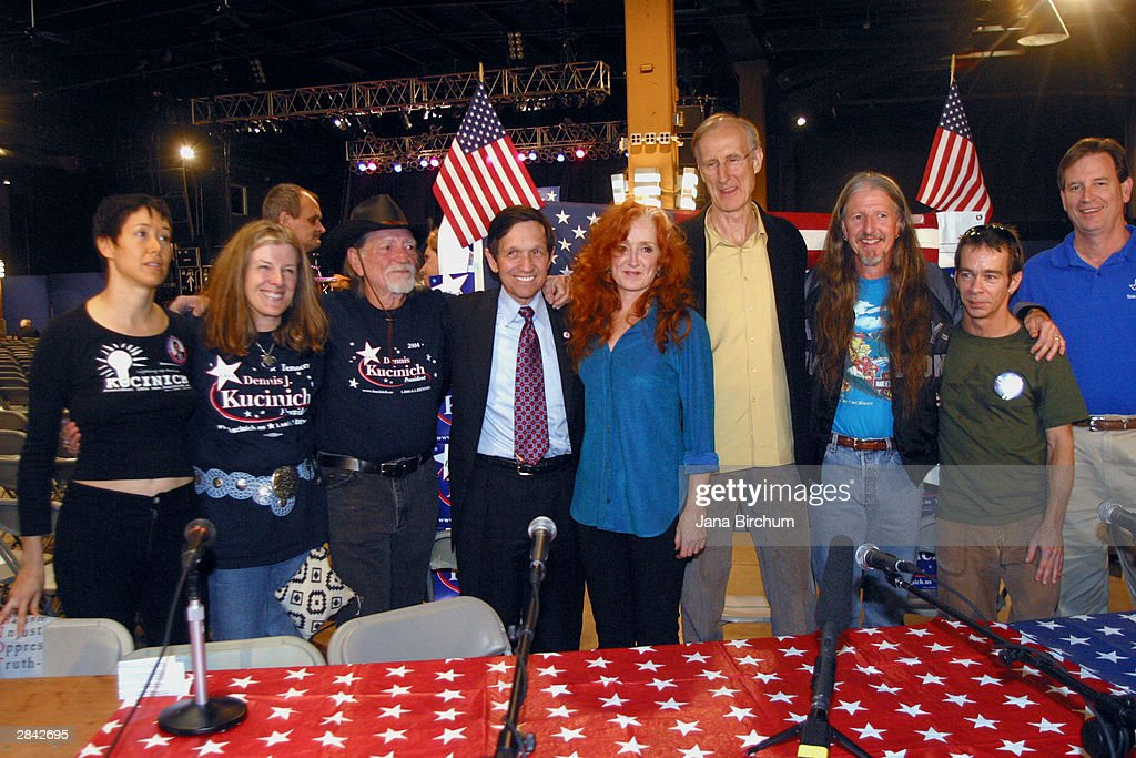 Presidential candidate Dennis Kucinich (4th L) receives the support of musicians Willie Nelson (3rd L) and Bonnie Raitt (C) at a fundraiser January 3, 2004 in Austin, Texas. The fundraiser was designed to elevate the name of Kucinich, who has received little recognition among voters outside his home state.