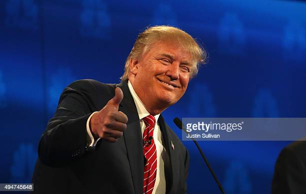 Presidential candidate Donald Trump gives a thumbs up during the CNBC Republican Presidential Debate at University of Colorados Coors Events Center...