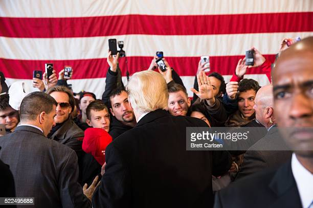 Presidential candidate Donald Trump interacts with supporters following a rally for his campaign on April 10 2016 in Rochester New York