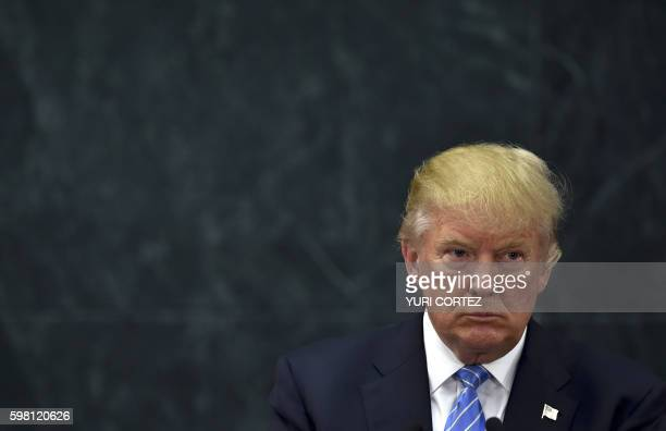US presidential candidate Donald Trump looks on during a joint press conference with Mexican President Enrique Pena Nieto in Mexico City on August 31...