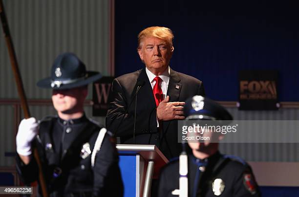 Presidential candidate Donald Trump pauses during the Star Spangled Banner in the opening of the Republican Presidential Debate sponsored by Fox...