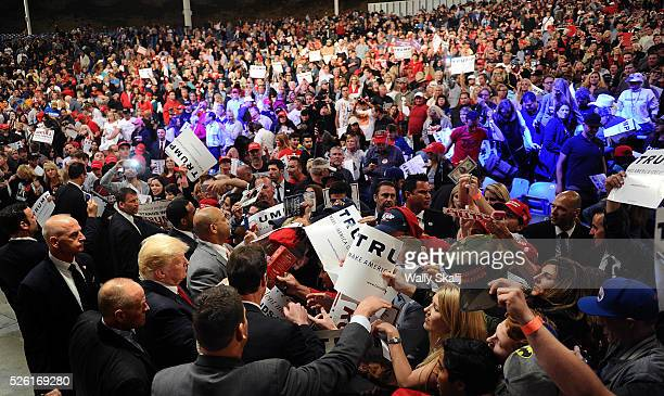 Presidential candidate Donald Trump shakes hands and signs autographs at a rally at the Orange County Fairgrounds in Costa Mesa Thursday, April 28,...