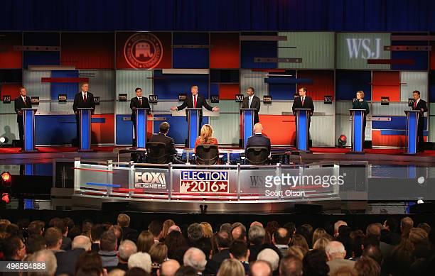 Presidential candidate Donald Trump speaks with Ohio Governor John Kasich Jeb Bush Sen Marco Rubio Ben Carson Ted Cruz Carly Fiorina and Sen Rand...
