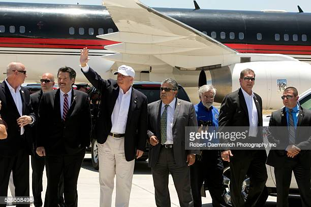 US Presidential candidate Donald Trump with local Laredo Texas officials including Mayor Pete Saenz and Laredo City Manager Jesus M Olivares upon Mr...