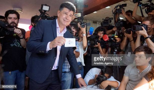 Presidential candidate Efrain Alegre of 'Ganar' alliance votes at a polling station during the presidential election in Asuncion Paraguay on April 22...