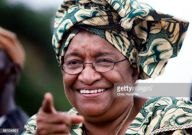 Presidential candidate Ellen Johnson Sirleaf waves to supporters during a support parade November 6 2005 in Monrovia Liberia Ellen as she universally...
