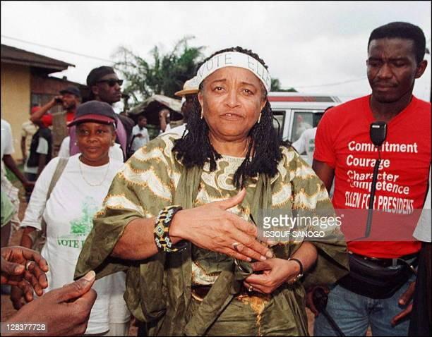 Presidential candidate Ellen JohnsonSirleaf arrives at Moulton corner displaced center on the outskirts of Monrovia 16 July as she winds up her...