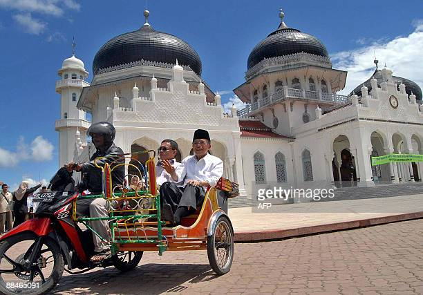 Presidential candidate for Indonesia's Golkar Party leader and incumbent Vice President Jusuf Kalla pass the Besar Baiturrahman mosque while...