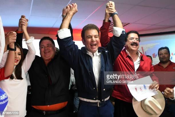 Presidential candidate for the Honduran Opposition Alliance against the Dictatorship Salvador Nasralla gestures with Iroshka Elvir de Nasralla...