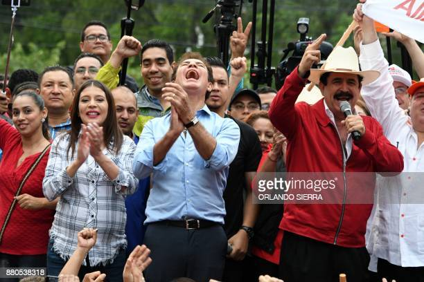 TOPSHOT Presidential candidate for the Honduran Opposition Alliance against the Dictatorship Salvador Nasralla claps as former President Manuel...