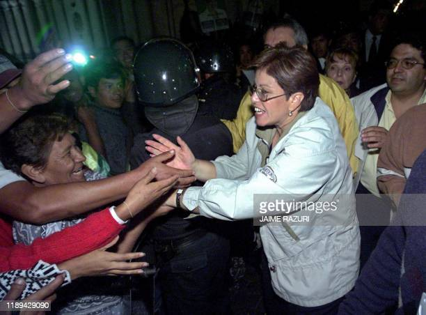 Presidential candidate for the National Unity party Lourdes Flores greets her supporters in Arequipa Peru 05 April 2001 protected by antiriot police...