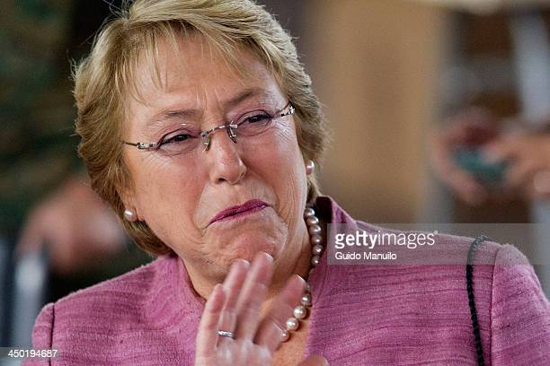 Presidential candidate for the New Majority coalition Michelle Bachelet casts her vote at the polls on November 17 2013 in Santiago Chile Around 9...