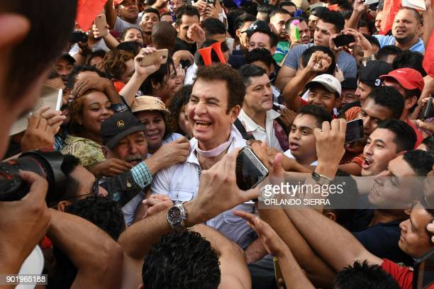 Presidential candidate for the Opposition Alliance Against the Dictatorship Salvador Nasralla leads a march to claim Honduras' presidency in San...