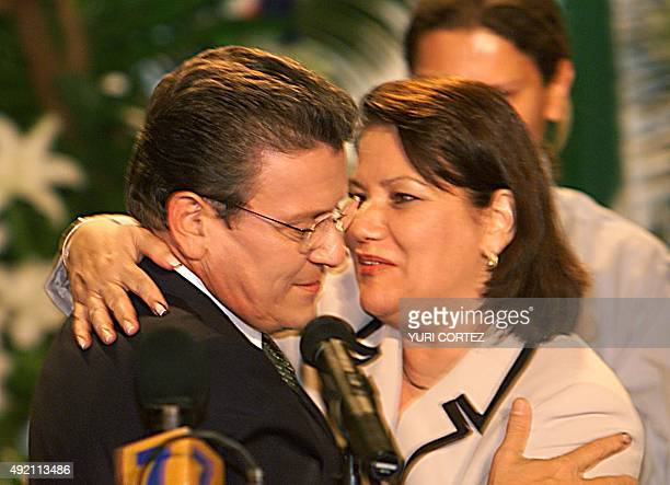 Presidential candidate for the Partido Liberacion Nacional Rolando Araya is comforted by his wife Leny Araya after the announcement that Abel Pacheco...