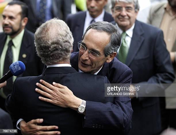 Presidential candidate for the Unidad Nacional de la Esperanza party, Alvaro Colom , embraces Guatemala City Mayor elect Alvaro Arzu of the Partido...