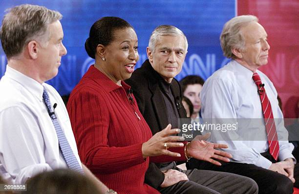 Presidential candidate former senator Carol Moseley Braun answers a question as Sen Joe Lieberman former Vermont governor Howard Dean and Retired...