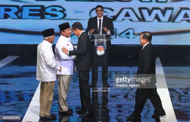 Presidential candidate from Great Indonesian Movement Party Prabowo Subianto shakes hand with presidential candidate from Indonesian Democratic Party...