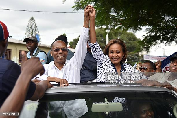TOPSHOT Presidential Candidate from Lavalas Political Party Maryse Narcisse with former President Jean Bertrand Aristide greet their supporters...