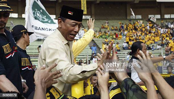 Presidential candidate General Wiranto greets his supporters at a large rally in the countrys capital on June 13 2004 in Jakarta Indonesia The...
