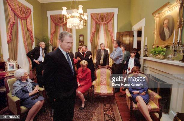 Presidential candidate George W Bush and his wife Laura Bush watches election returns with their family the Cheneys and friends at the Texas...