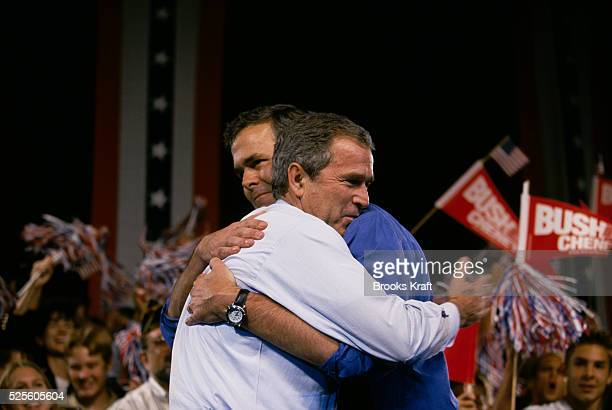 Presidential candidate George W Bush hugs his brother Jeb Bush during a jubilant presidential campaign rally George W Bush is running for the 2000...