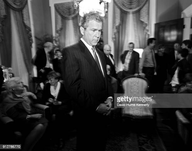 Presidential candidate George W Bush watches election returns with their family the Cheneys and friends at the Texas Governor's Mansion on election...