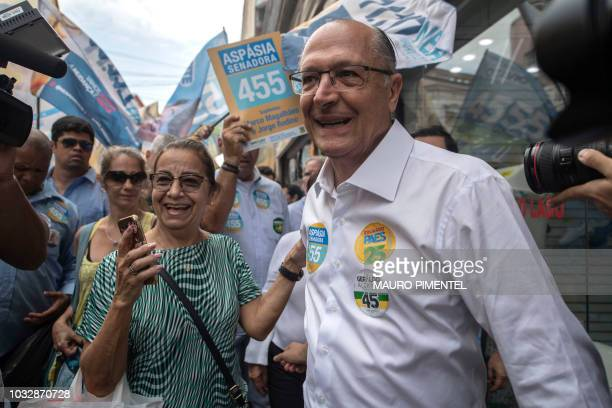 Presidential candidate Geraldo Alckmin for the Brazilian Social Democratic Party greets supporters while campaigning in downtown Rio de Janeiro...