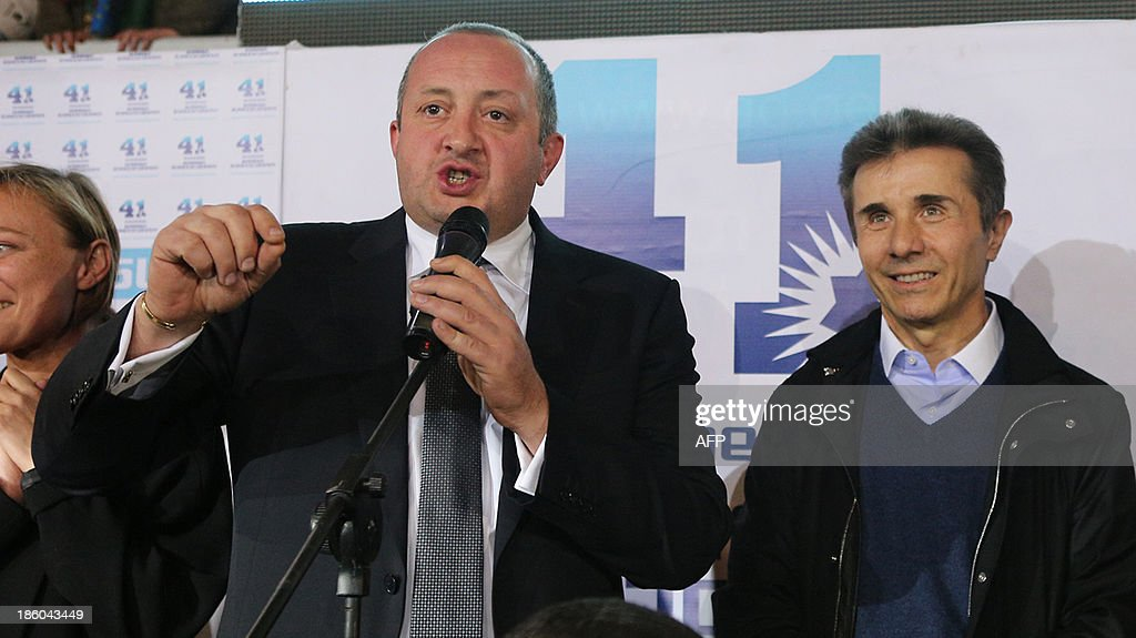 Presidential candidate Giorgi Margvelashvili (L) speaks as Georgian Prime Minister Bidzina Ivanishvili looks on as they celebrate at the Georgian Dream coalition's headquarters in Tbilisi, on October 27, 2013. A close ally of billionaire Georgian Prime Minister Bidzina Ivanishvili was on course to win a crushing victory at presidential polls on October 27, 2013 in the post-Soviet country, partial results from the electoral commission showed. Giorgi Margvelashvili -- from Ivanishvili's Georgian Dream coalition -- was on 63.8 percent of the vote with some 12 percent of polling stations counted, the electoral commission said, with challenger David Bakradze from outgoing president Mikheil Saakashvili's United National Movement party, back on 21.3 percent.