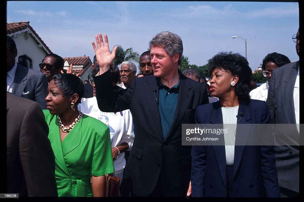 Presidential candidate Governor Bill Clinton (D-AR) stands with US Representative Maxine Waters (D-CA) May 4, 1992 in Los Angeles, CA. The south-central area of Los Angeles was torn with riots following the acquittal of five officers who were accused of beating African-American Rodney King.