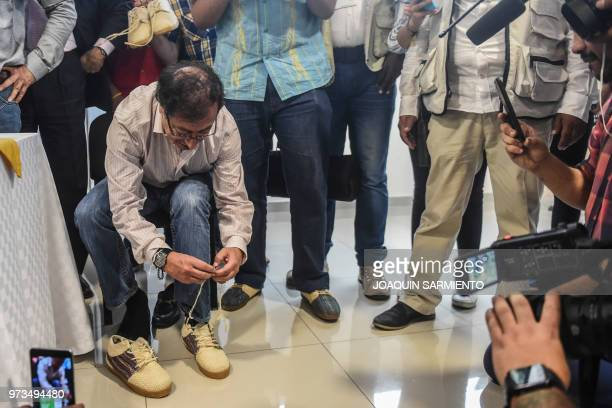 Presidential candidate Gustavo Petro, from Colombia Humana Movement, puts shoes on during a political rally ahead of the runoff election, in...