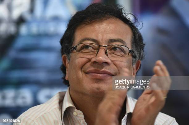 Presidential candidate Gustavo Petro, from Colombia Humana Movement, applauds during a political rally ahead of the runoff election, in Medellin,...
