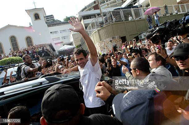 Presidential Candidate Henrique Capriles greets his supporters after voting on October 07 2012 in Caracas Venezuela