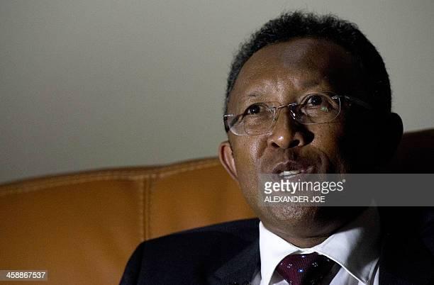 Presidential candidate Hery Rajaonarimampianina of Hery Vaovao ho an'i Madagasikara party talks to a journalist in Antananarivo on December 22 2013...