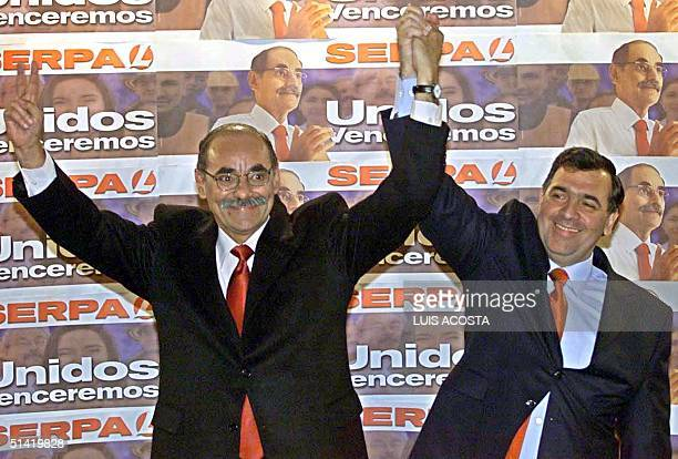 Presidential candidate Horacio Serpa of the Liberal Party raises arms with running mate Jose Gregorio Hernandez in Bogota 31 March 2002 Serpa...
