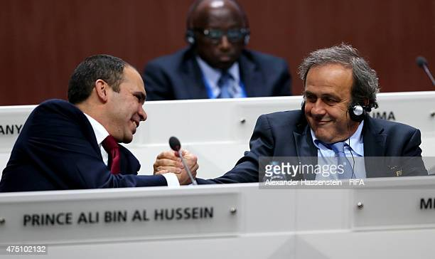 Presidential candidate HRH Prince Ali Bin Al Hussein of Jordan shakes hands with UEFA President Michel Platini of France during the 65th FIFA...