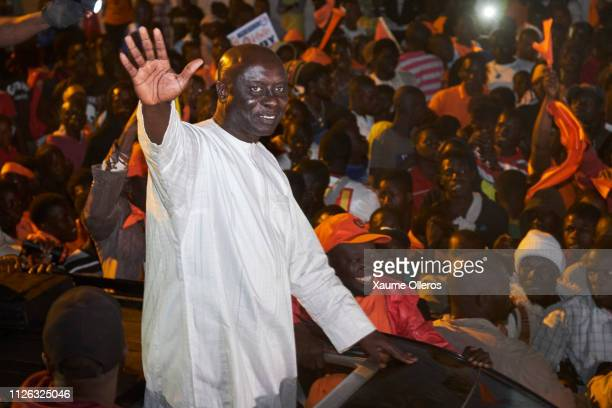 Presidential candidate Idrissa Sall greets the crowd as he arrives to Mbour village on February 20 2019 in Mbour Senegal