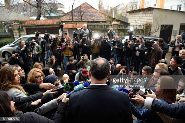 Presidential candidate Igor Dodon adresses journalists after voting at a polling station in Chisinau on November 13 2016 Moldova went to the polls on...