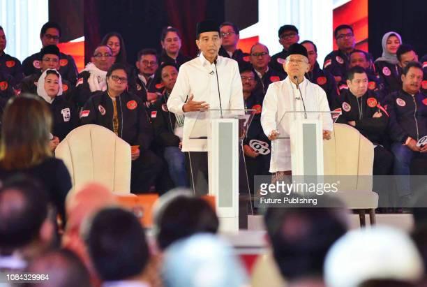 Presidential candidate incumbent President Joko Widodo and his running mate Maruf Amin speak during a debate among candidates in Jakarta Indonesia 17...