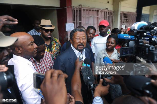 Presidential candidate Jean Ping speaks to journalists at the Martine Oulabou school in Libreville before voting for the Gabon's presidential...