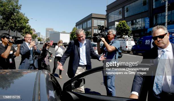Presidential candidate Jeb Bush heads back into a Uber car after meeting with employees at Thumbtack in San Francisco, Calif., on Thurs. July 16,...