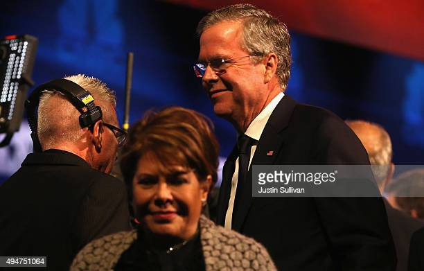 Presidential candidate Jeb Bush walks off stage with his wife Columba after the CNBC Republican Presidential Debate at University of Colorados Coors...
