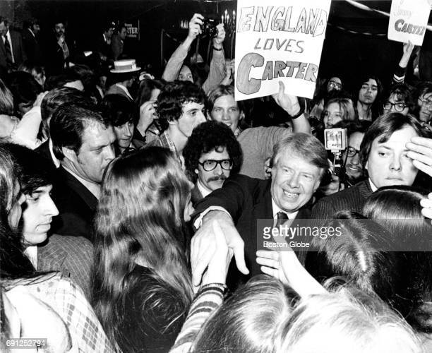 Presidential candidate Jimmy Carter greets a crowd at the Carpenter Hotel in Manchester NH on Feb 24 1976