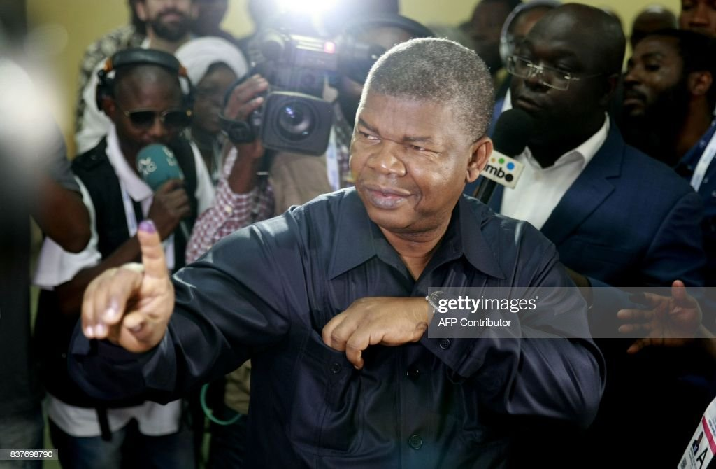 presidential candidate Joao Lourenco shows his inked finger after voting in Luanda, on August 23, 2017 during the general elections. Angolans cast their ballots on August 23 in an election marking the end of President Jose Eduardo Dos Santos's 38-year reign, with his MPLA party set to retain power despite an economic crisis. /