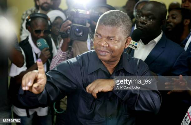 presidential candidate Joao Lourenco shows his inked finger after voting in Luanda on August 23 2017 during the general elections Angolans cast their...